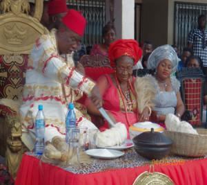 Igwe Nnaji cuts through the yam