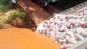 Cement-laden Dangote truck falls on the bridge
