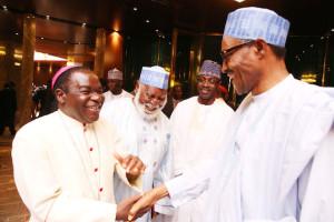 President Buhari and Bishop Kukah during a visit at the Presidential Villa, Abuja