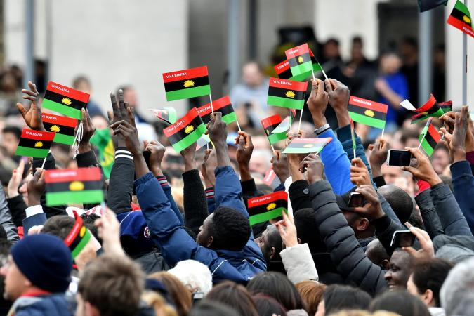 Biafra activists wave flags at St. Peter;s Square in Rome